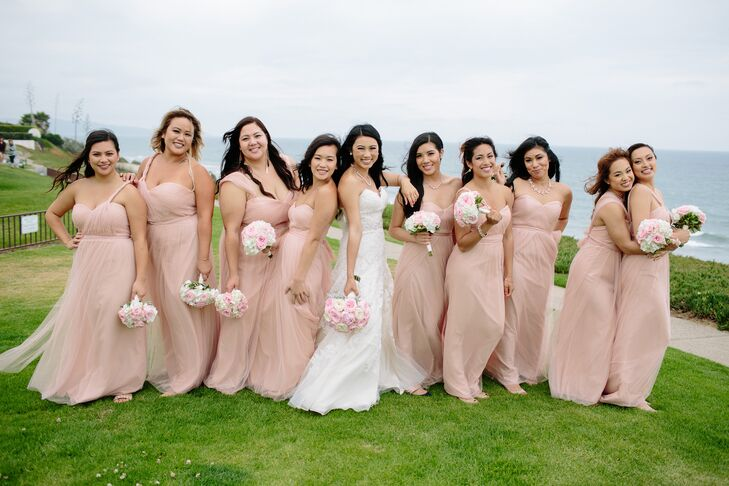Nancy's bridesmaids wore pale pink convertible dresses from Jenny Yoo.