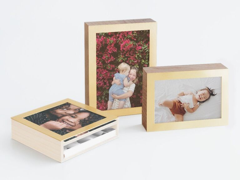 Three wood and brass photo boxes with cute family pictures