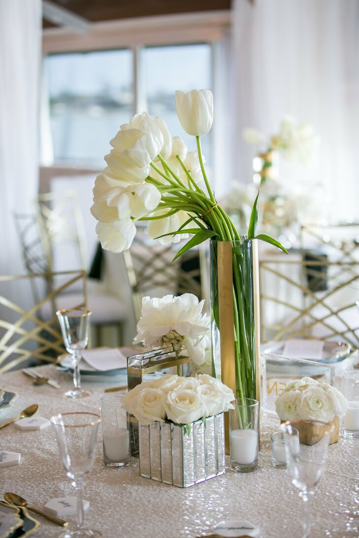 At the indoor reception at Balboa Yacht Club in Corona del Mar, California, the decor was chic and modern. Round tables were topped with sequined tablecloths and tall clear vases filled with white tulips and shorter square boxes filled with white roses.