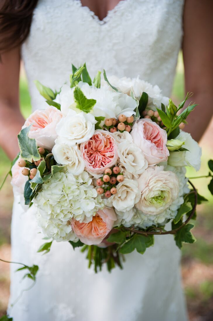 The floral arrangements displayed an abundance of ivy and grape leaves mixed in to incorporate the romantic Italian theme. Shelby's bouquet included blush garden roses, white ranunculus and hypericum berries for added romance.