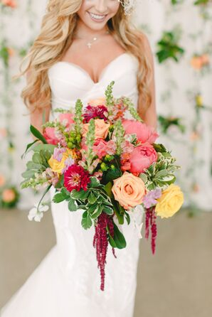 Bride with Bright Bouquet of Peach Roses, Ranunculus and Greenery