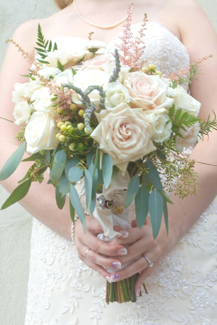 Jennie carried a lush bouquet with Sahara roses, Vendela roses, cream hypericum berries, pink astilbes, ferns and eucalyptus.