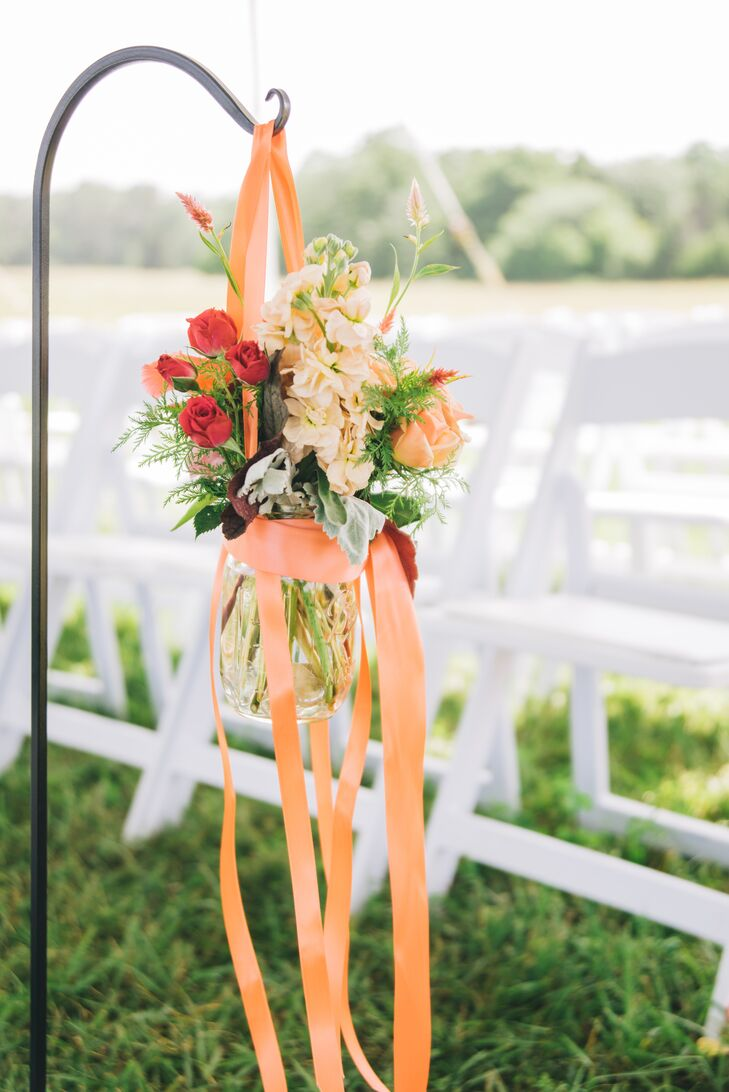 Ceremony Aisle Floral Arrangement With Orange Ribbon