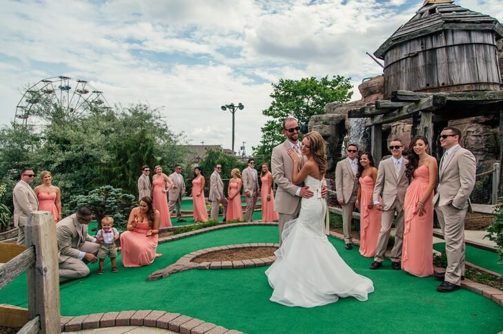 """I wanted to make sure all my bridesmaids were comfortable and felt amazing in their dresses, which is why we went with different styles in the same color,"" Kristie says. Each woman walked onto the boardwalk's mini golf green in a long salmon dress with a ruffle along the front and her choice of neckline. To change things up a bit more, they also chose different hairstyles. The groomsmen kept things a bit simpler with matching neutral suits and striped ties."