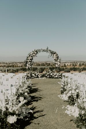 Floral Ceremony Arch and White Chairs  in Rolling Hills Estates, California