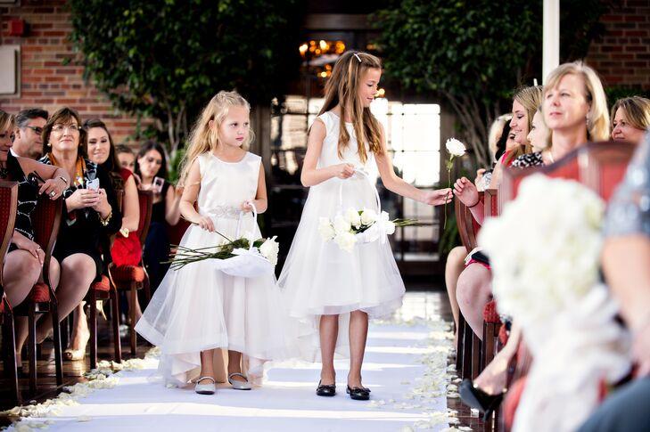 Flower Girls Hand Out White Long-Stem Roses