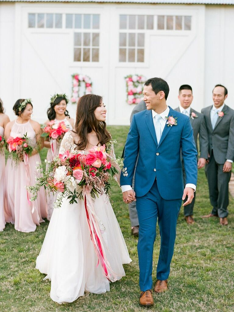 bride and groom with pink florals in Texas
