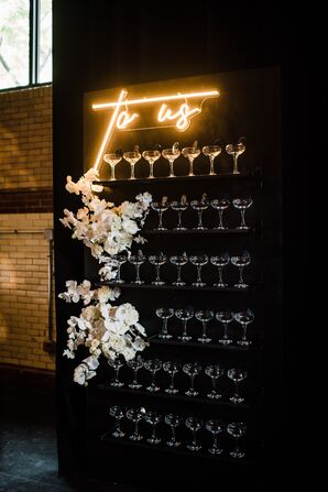 Glamorous Champagne Display with Flowers and Lighted Sign