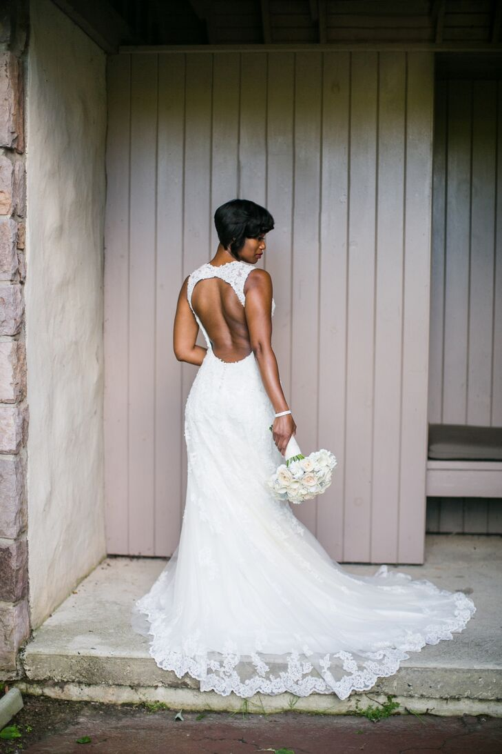 Dawnyelle wore a slim sheath-style Sophia Tolli dress that was adorned in tulle and crystal hand-beaded lace appliques. The sweetheart neckline had matching lace shoulder straps that continued into a dramatic plunging keyhole back. Her accessories included a thin crystal belt.