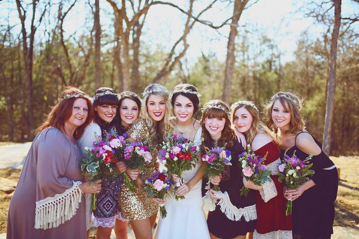 For her bridesmaids, Madelyn had each girl choose her own dress to create a mismatched effect that would complement the wedding's bohemian theme. The women donned flowing, peasant dresses for the affair in varying shades of purple, pink red and gold, rounding out their ensembles with romantic waves and dainty flower crowns.
