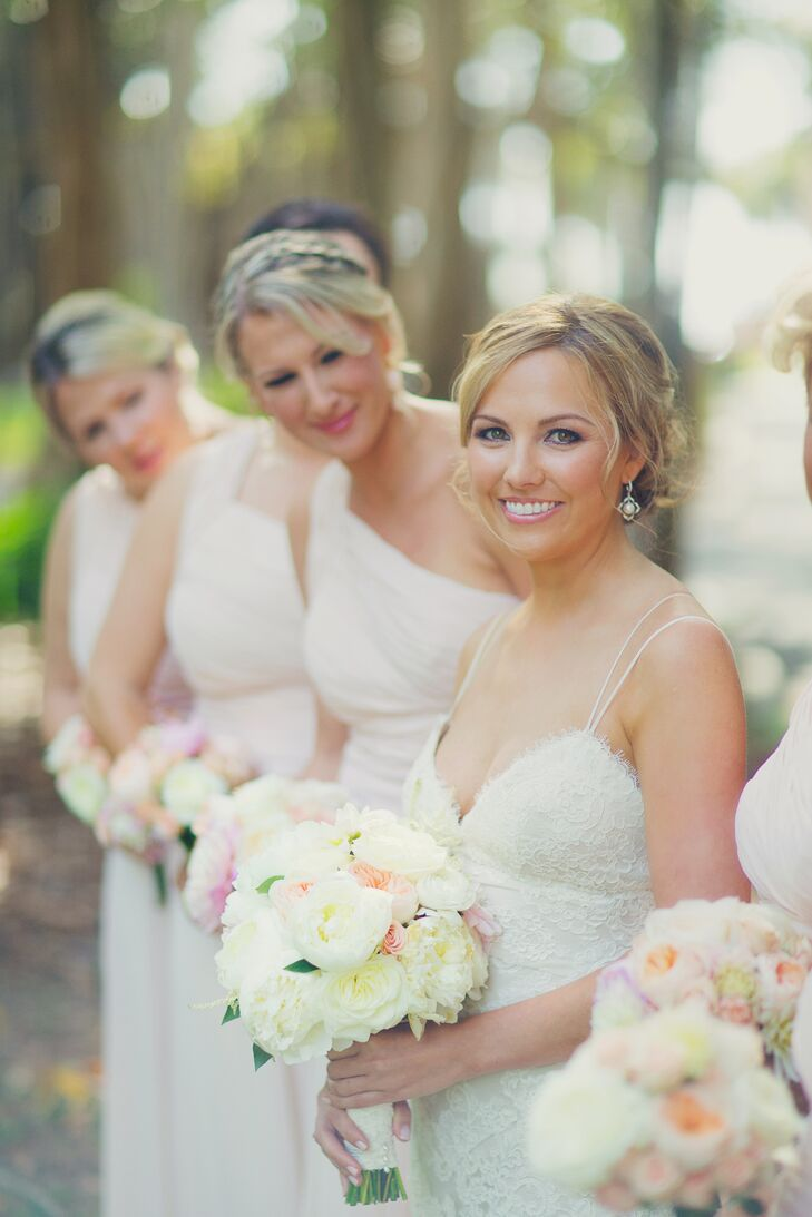 "Molly accented her lace Monique Lhuillier wedding dress with natural airbrush makeup and a twisted Chignon hairstyle. She also added an heirloom to her updo. ""I wore a pearl and crystal hair comb given to me by my Nana,"" says Molly."