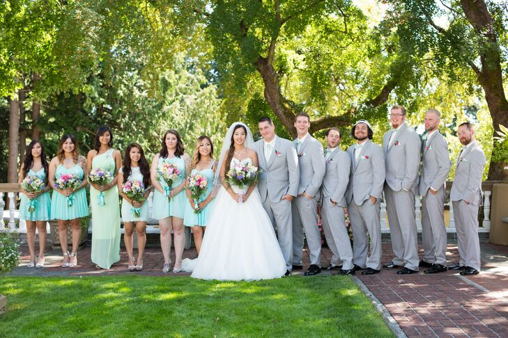 The bridesmaids chose their own dress in a shade of mint, which resulted in a range of styles and hues that went together nicely. The dresses matched the groomsmen's mint green bow ties and pocket squares.