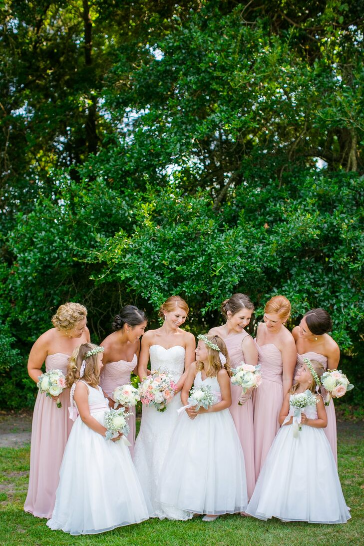Haley's bridesmaids were dressed in subtle yet elegant strapless, chiffon floor-length Mori Lee dresses. The blush color coordinated with the men's bow ties as well as the rest of the wedding day decor.