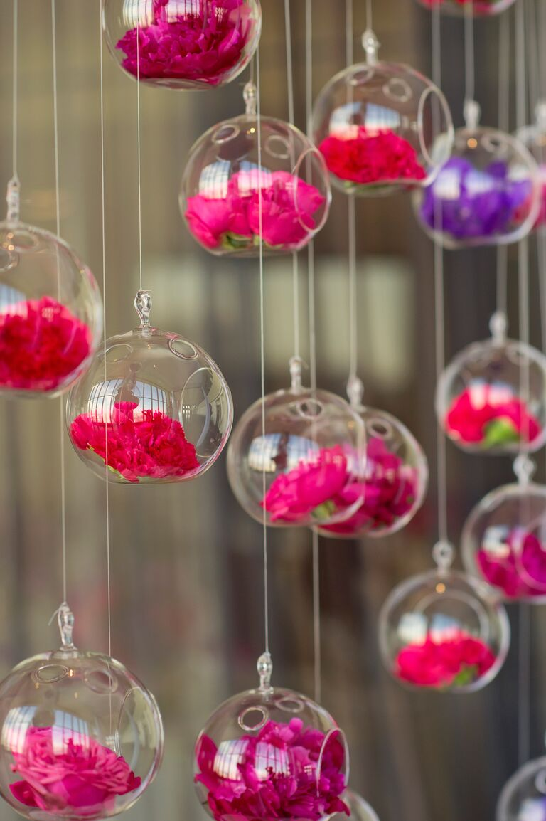Hanging glass globe vases at wedding ceremony