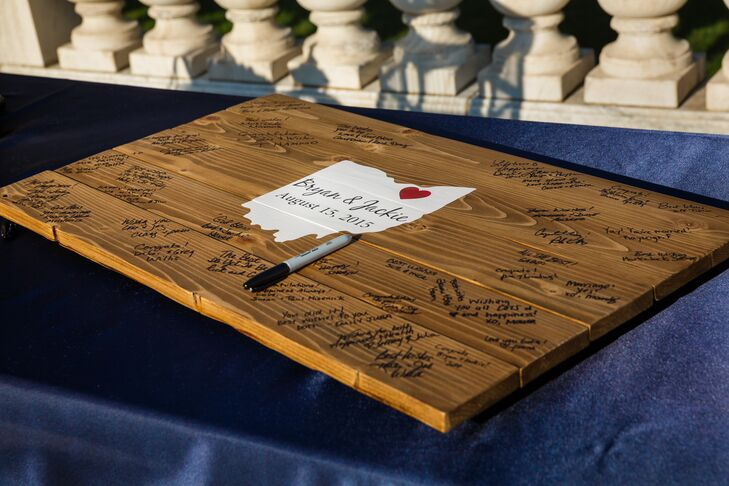 Instead of having a traditional book, Jackie and Bryan had guests sign a wooden board that depicted the state of Ohio in the middle. A small red heart showed in the corner of the Ohio design, representing their love for the state that brought them together.