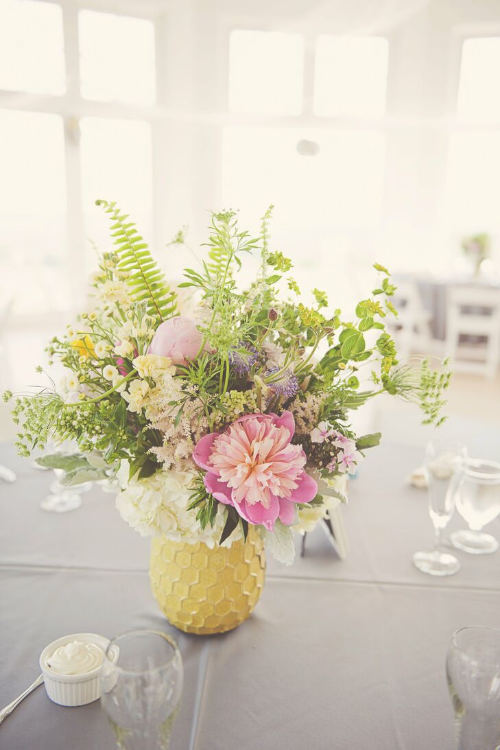 The first items purchased for the wedding were the West Elm honeycomb vases for the centerpieces.  The bride told the florist she wanted full arrangements, overflowing with spring flowers.