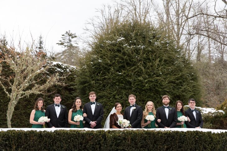 The bridesmaids wore the same green chiffon dresses by Lela Rose, and the groomsmen wore traditional black tuxedos from the Black Tux. Emily and Edward loved how the wedding party attire came together to create a chic, timeless look.