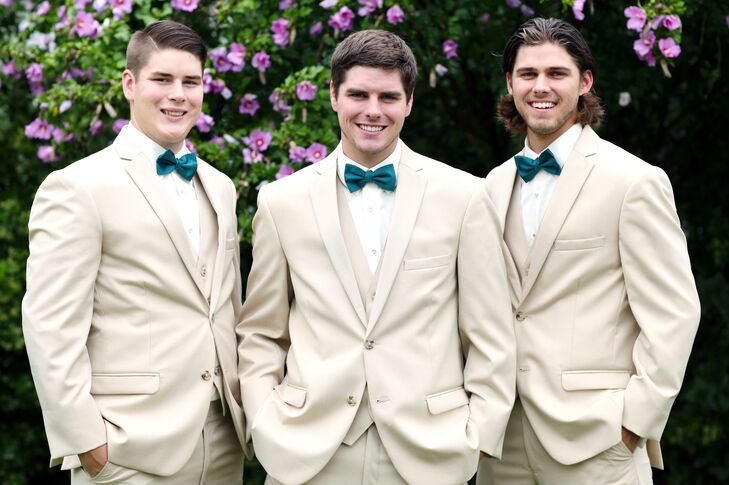Andrew and his groomsmen wore khaki three-piece suits and teal bow ties.