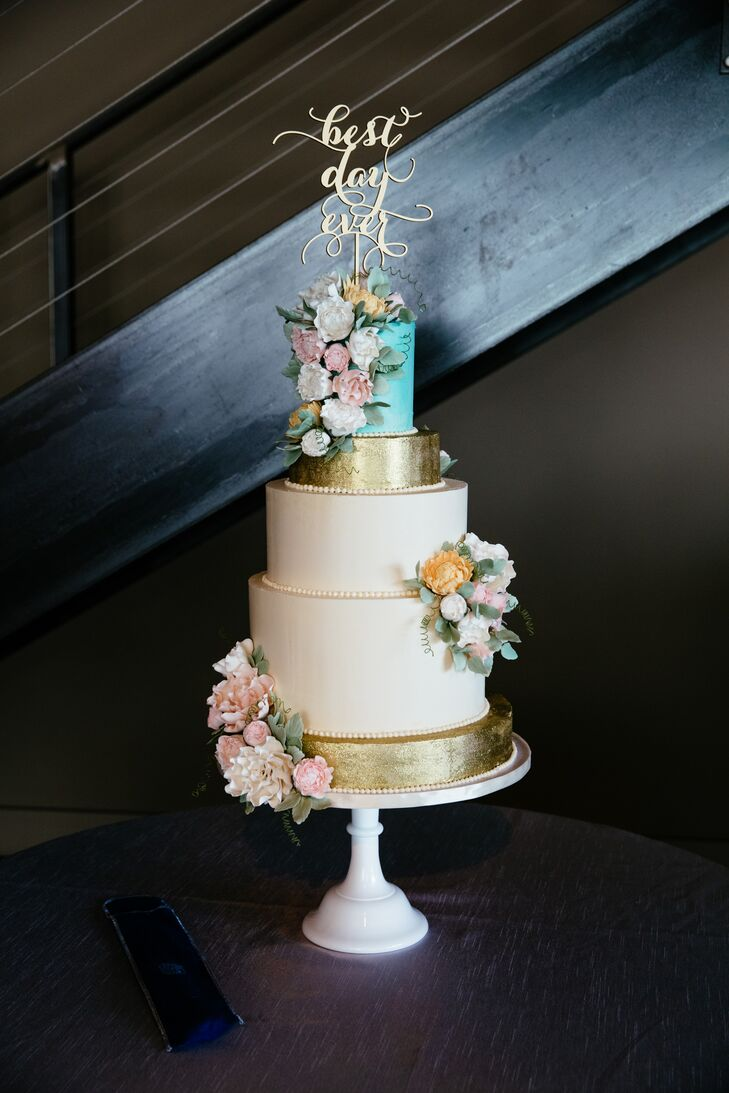 After dinner, Kate and Jordan treated guests to a slice of cake from Sugar Flower Bake Shop. The gilded, four-tier confection featured pistachio cake with strawberry filling, honey buttercream and clusters of sophisticated sugar flowers.