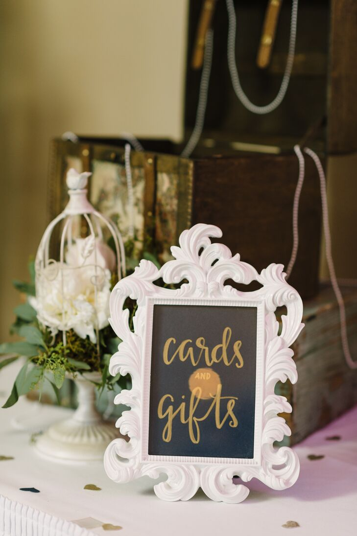Kelsie and Cody incorporated rustic details throughout Nazareth Hall in Grand Rapids, Ohio, including a vintage trunk draped in pearls to hold cards from guests.