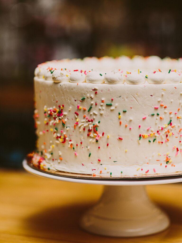 Simple white wedding cake with rainbow sprinkles
