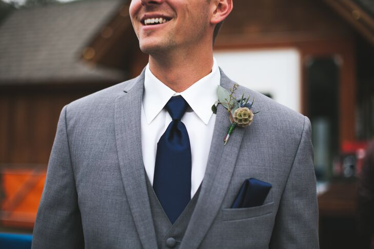 The groomsmen wore scabiosa pods and blue thistle for their rustic boutonnieres.