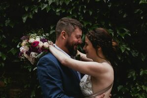 Romantic Couple with Braided Bridal Updo and Modern Bouquet