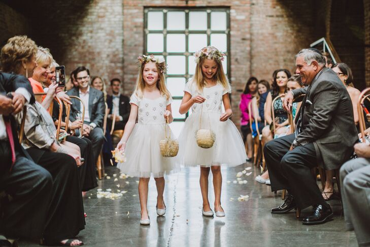 Ben's nieces, Lily and Violet, were destined to be flower girls, Lauren says of their floral-inspired names. They donned matching TK dresses and flower crowns for their walk down the aisle.