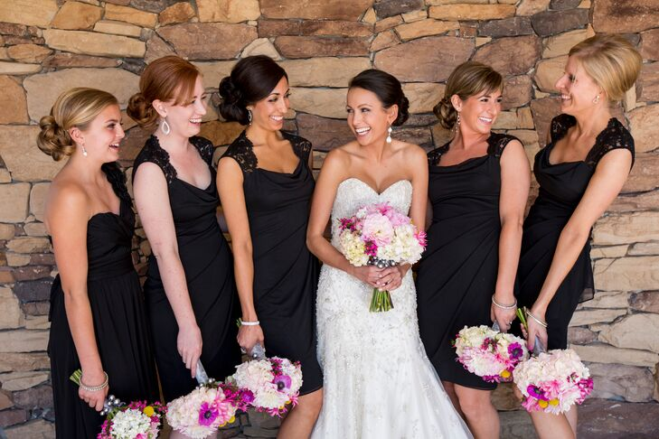 The bride's four bridesmaids wore black knee length dresses with lace straps and an open back detail. Her niece was a junior  bridesmaid and wore a black one shoulder dress.