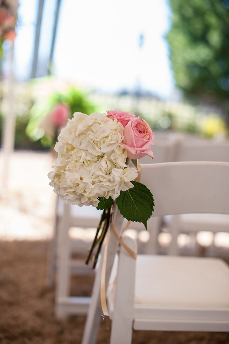The hydrangea and rose ceremony flowers complemented the bride's bouquet of pink roses, mums and greenery.