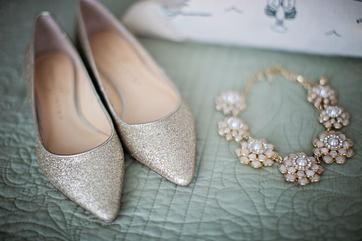 Talitha walked down the aisle in these glittered Ivanka Trump ballet flats and this crystal and pearl Kate Spade necklace.