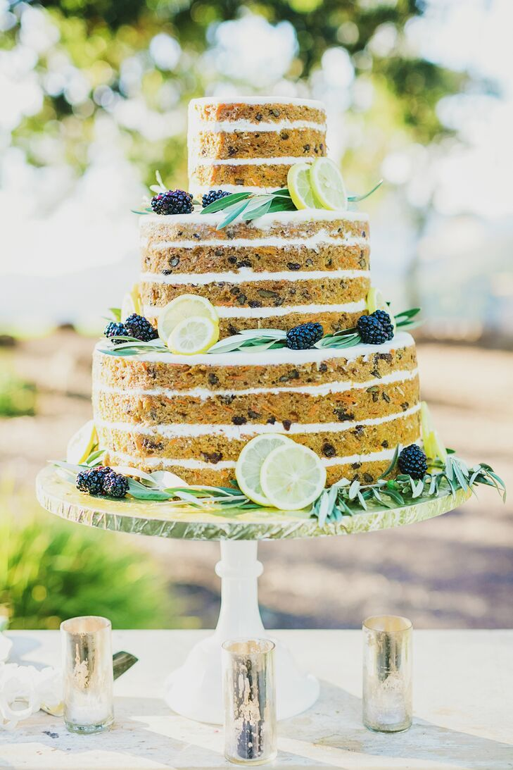 Sweetie Pies bakery in Napa, California, created Emily and Vishal's unfrosted, naked three-tier carrot cake with cream cheese filling. The slightly buttoned-down cake design was perfect for the sunny, rustic setting.