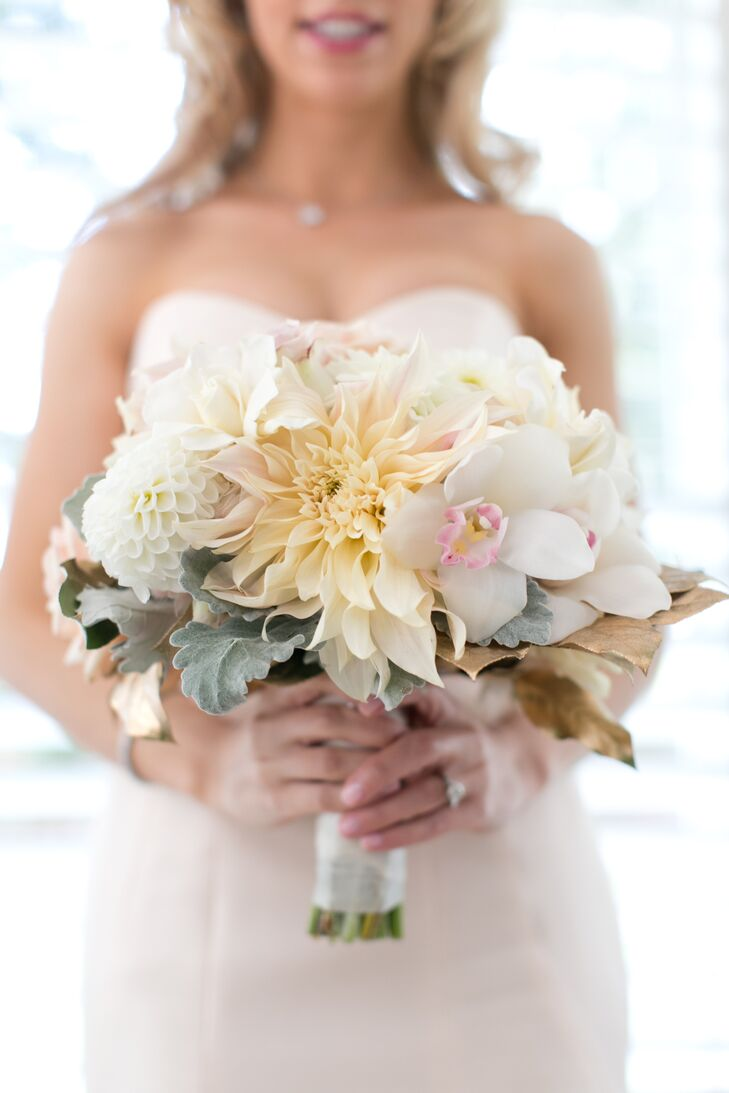 Laura's bouquet consisted of ivory and white blooms, including orchids and greenery.