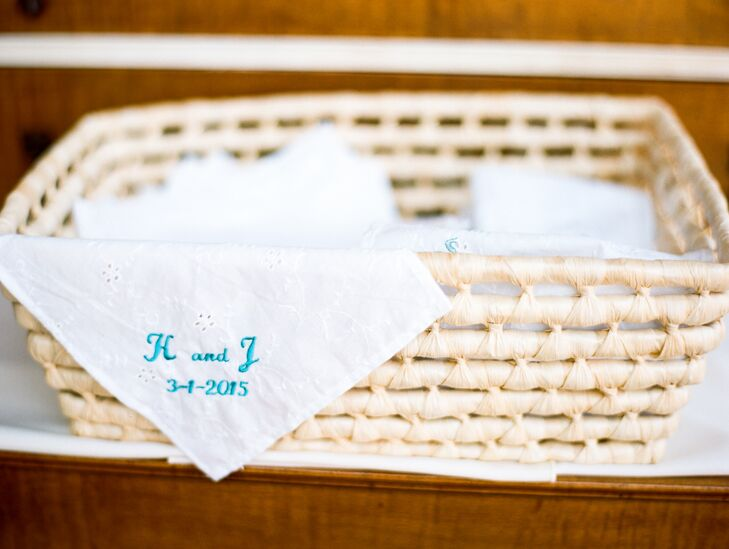 The groom's mother hand-embroidered more than 100 handkerchiefs for the guests to wave as the couple left the chapel after the ceremony.