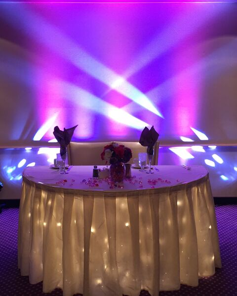 Sweetheart table after uplighting