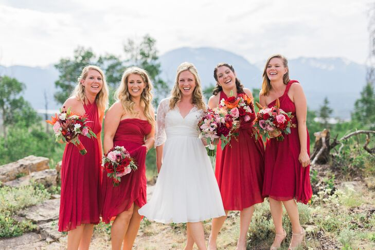 For the wedding party, Lindsay and Jeff went for a coordinated, mismatched look. The bridesmaids donned convertible Dessy dresses in siren red, while the guys paired dark denim with button-down shirts and red ties.