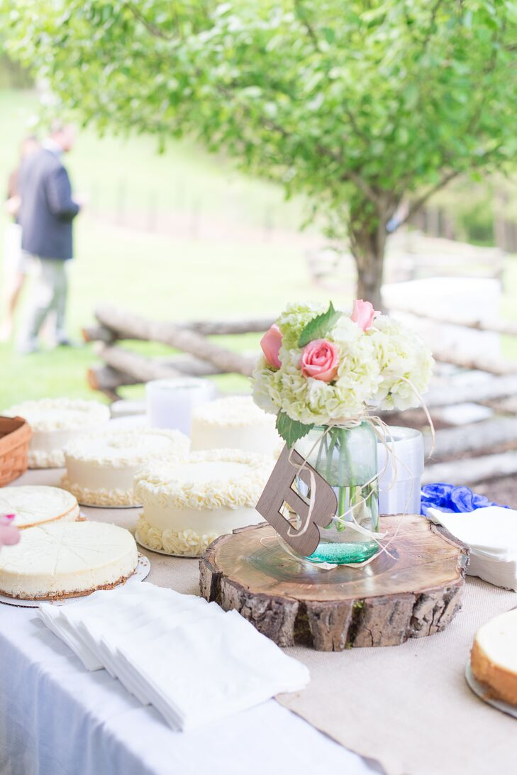 After dinner, guests indulged in their choice of sweet treats before hitting the dance floor. The couple offered an array of flavorful cakes and cheesecakes, which they displayed buffet style alongside decorative rustic elements like large tree slices and mason jars filled with cheerful spring blooms like ivory hydrangeas and pink roses.