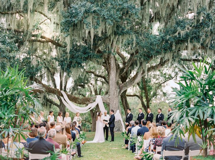Classic Backyard Wedding Ceremony with Trees and White Draping