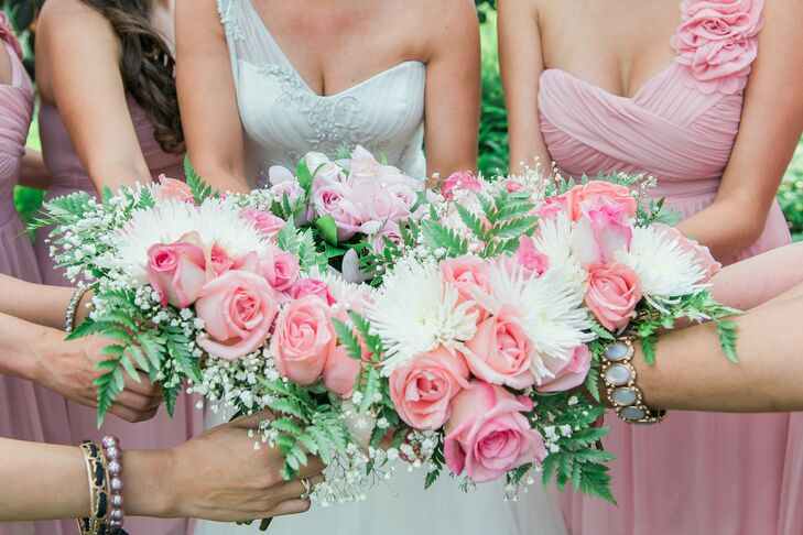 The bridesmaids carried pink rose and white spider mum bouquets.