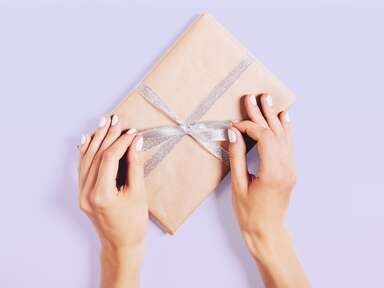 wrapped gift with purple ribbon
