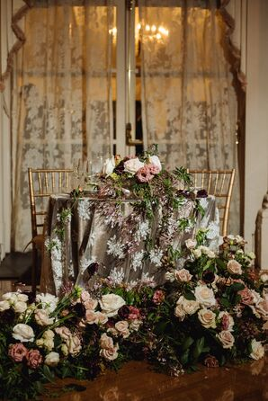 Blush and Plum Rose Sweetheart Table Floral Arrangements