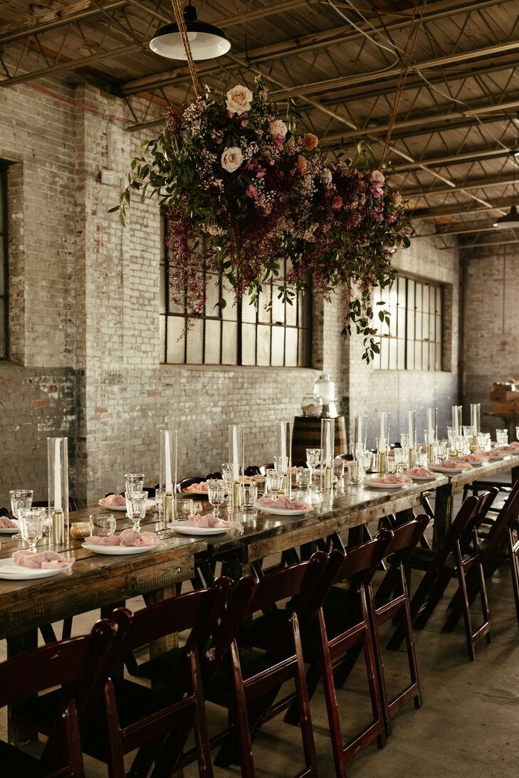 Industrial Wood Farm Table with Hanging Flowers and Bohemian Place Settings