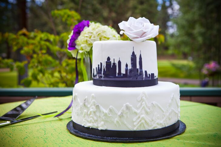 """The wedding cake was a true marriage of New York City and Lake Tahoe. """"The bottom layer was decorated with mountain silhouettes to represent Nevada where we both grew up, and the top with the New York City skyline where we have lived for 14 years,"""" says the bride."""