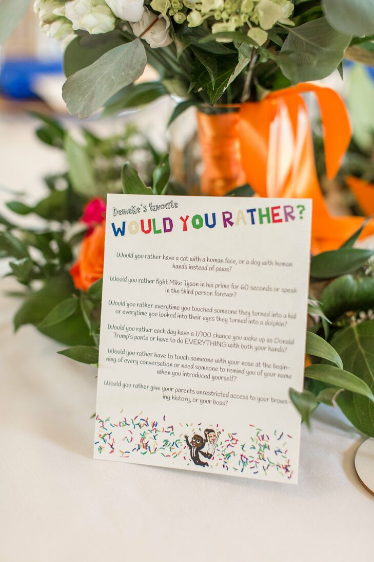 "On each table, Jasmine and Chris placed a cheeky ""would you rather"" game for guests to play during the reception at Morais Vineyards & Winery in Bealeton, Virginia."