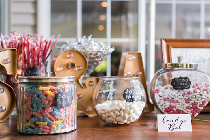 "In addition to a jam-packed dessert display, Samantha and Adam offered guests a candy bar stocked with Twizzlers, Sour Patch Kids, Jordan almonds, Hershey's Kisses and more. ""We wanted them all to leave with a lot of sweets,"" Samantha says."