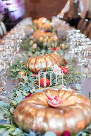Gilded Pumpkin and Eucalyptus Centerpieces and Roman Numeral Table Number