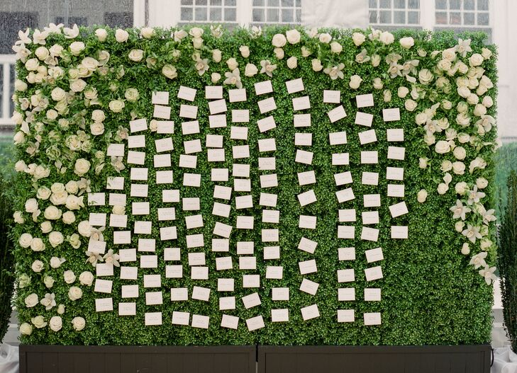 Escort Card Display on Greenery Wall