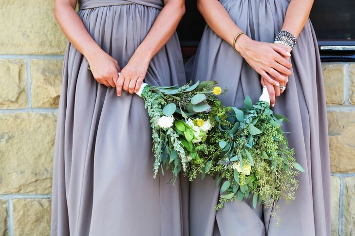 Bridesmaids carried natural arrangements that included seeded eucalyptus, eucalyptus leaves and craspedia for an added pop of color.
