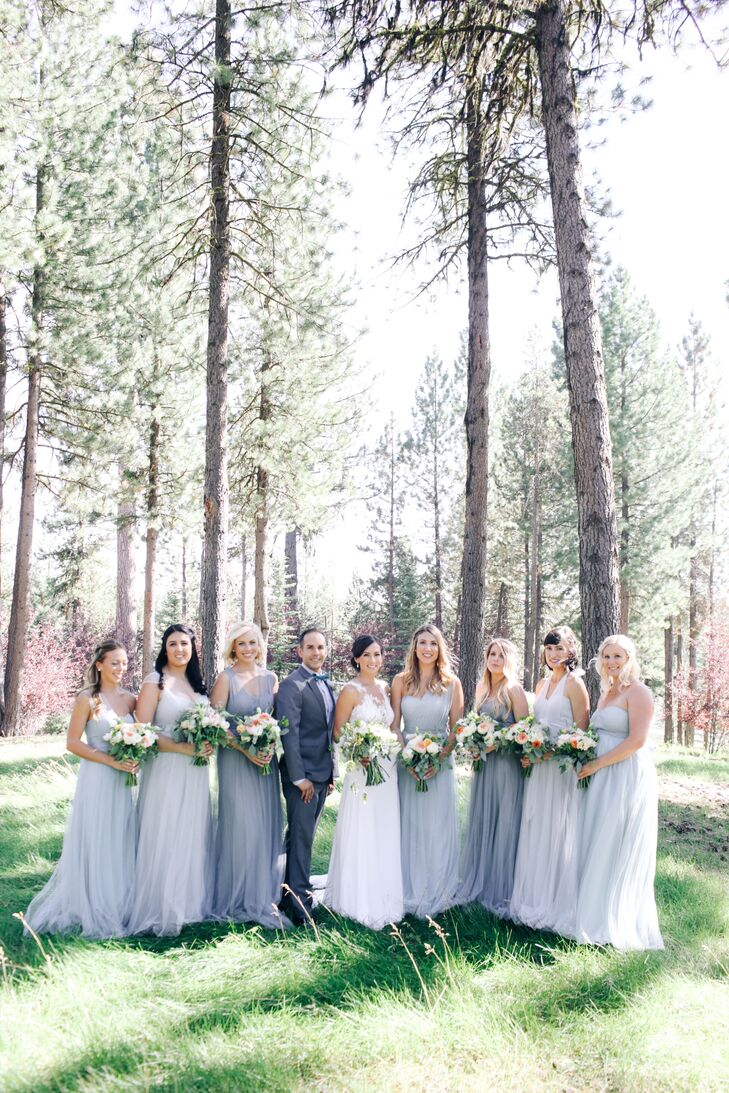The bridesmaids wore slate blue dresses by Jenny Yoo and carried wildflower-inspired bouquets.