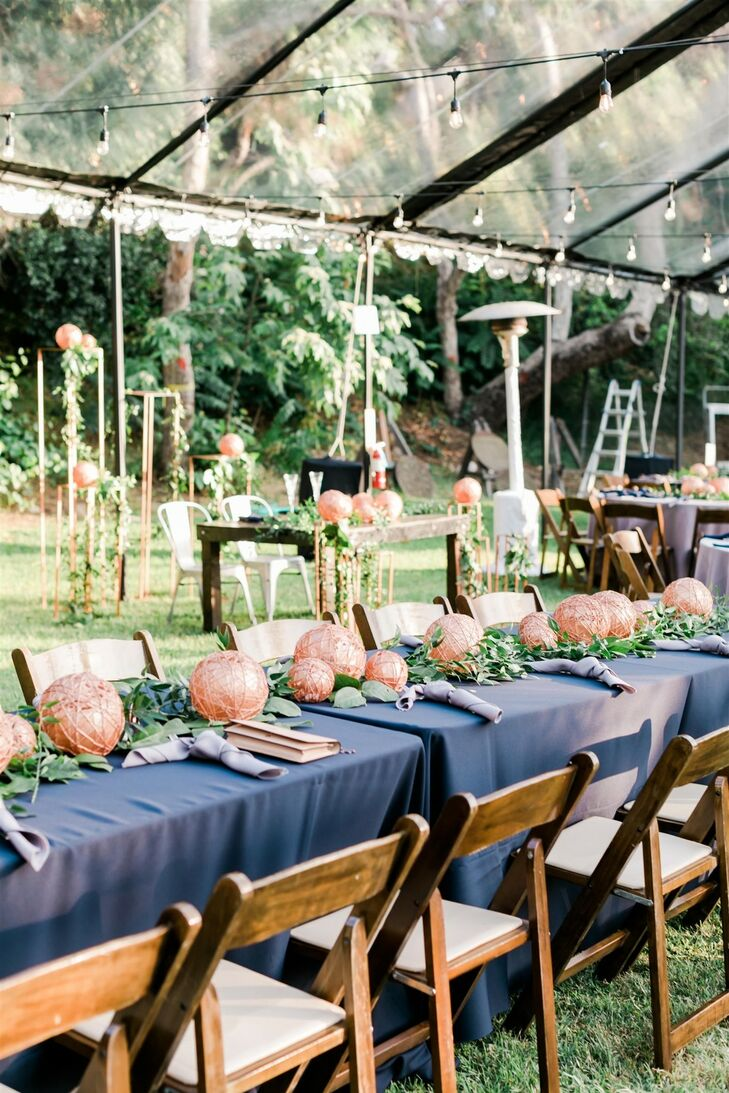 Dining Table with Folding Chairs, Blue Linens and Whimsical Centerpieces